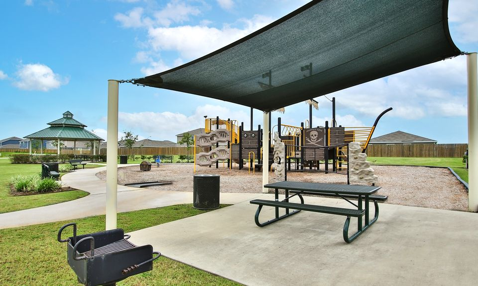 LGI Homes at Joseph's Cove:Shade screen and a picnic pavilion provide a cool escape at this community park.
