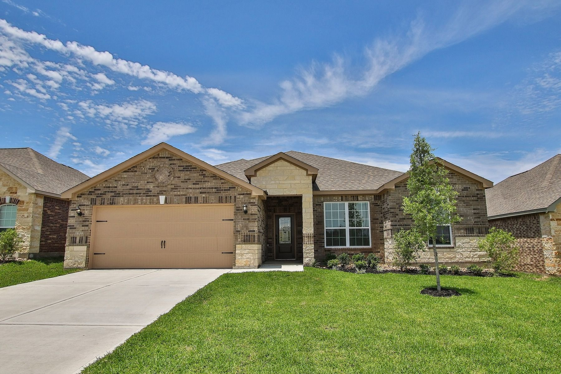 The Leland by LGI Homes at Bauer Landing:An attractive brick exterior with stone accents adds curb appeal to this incredible home at Bauer Landing.