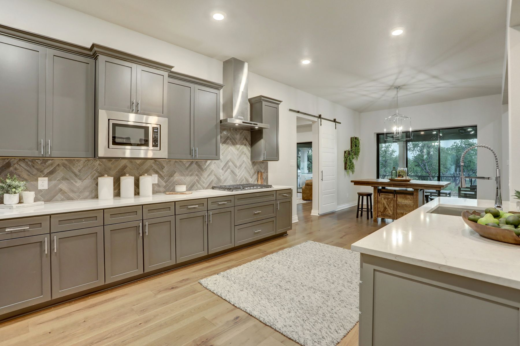 The Stratton by Terrata Homes:The kitchen comes with beautiful wood cabinetry and stainless steel appliances.