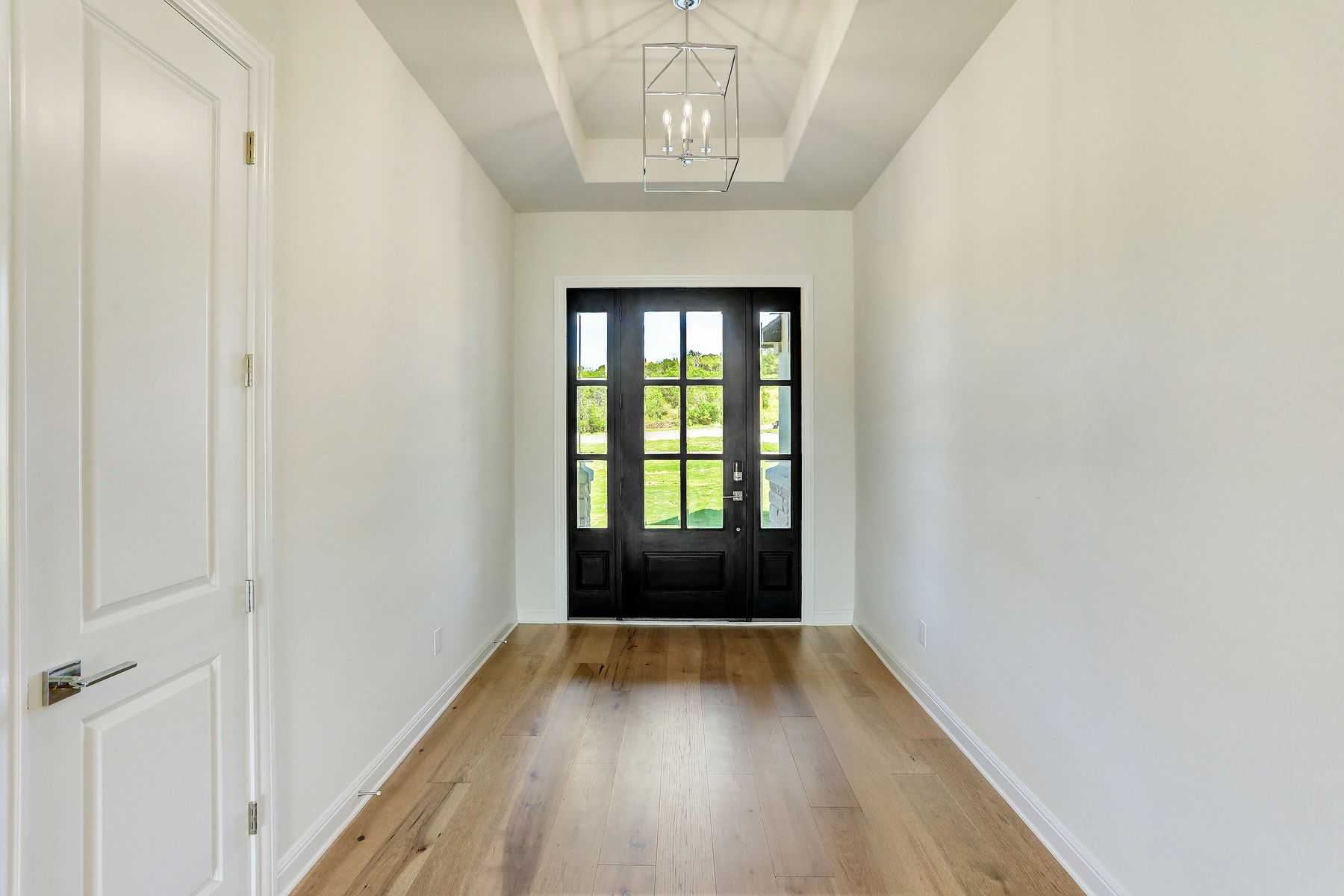 The Fairview Plan by Terrata Homes:Walk in to a majestic foyer highlighted by beautiful wood floors.