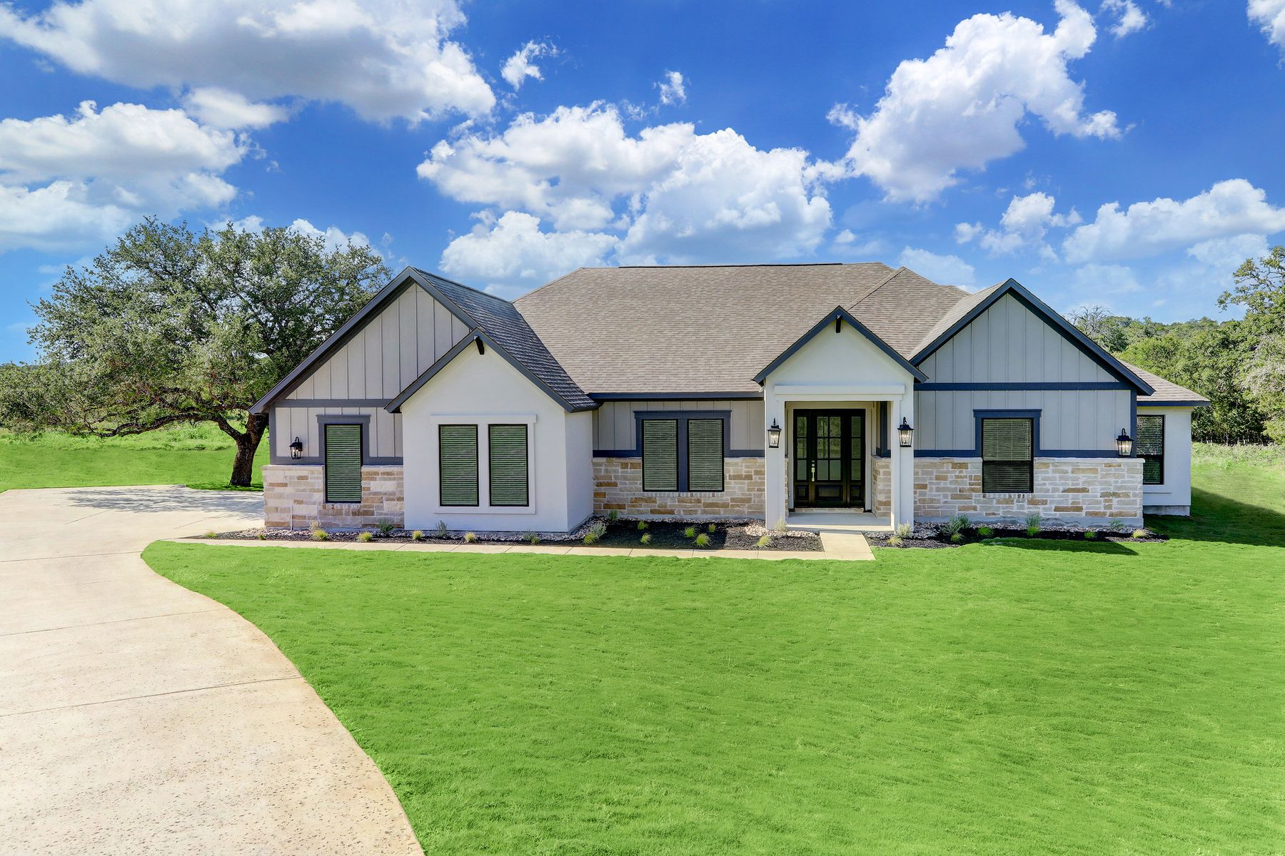 The Mantle Plan by Terrata Homes:This home is brimming with hill country charm and curb appeal.