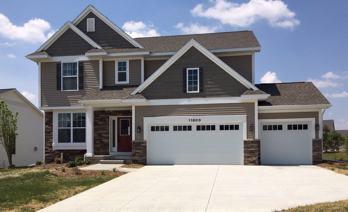 The Nantucket by Mayberry Homes:Welcome to the Nantucket. This is a WOW home - at every turn. The foyer leads to the first floor study and on to the wide open Great Room, dining, and kitchen areas - all graced with plenty of glass! A drop zone and Command Center off of the kitchen help