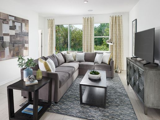 Large windows allows for natural light in the family room.