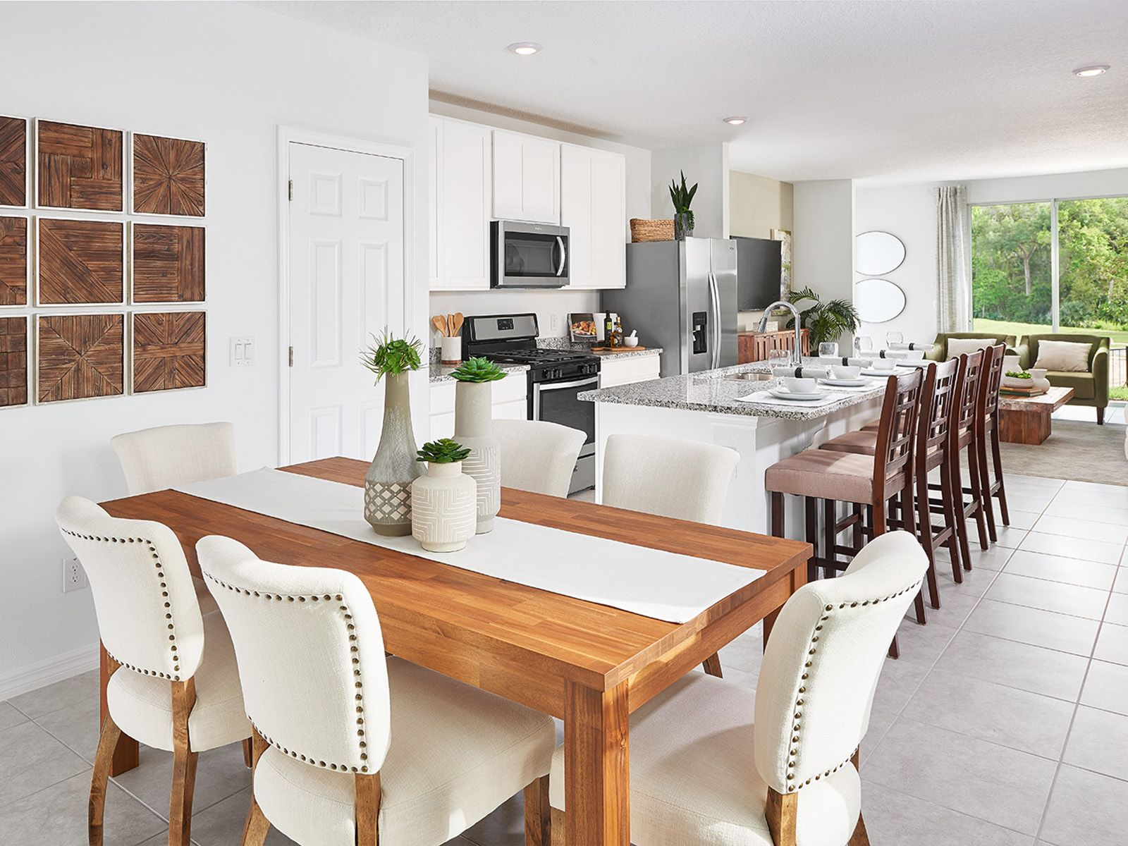 The dining and kitchen of the Canary as modeled at Lake Denham Estates