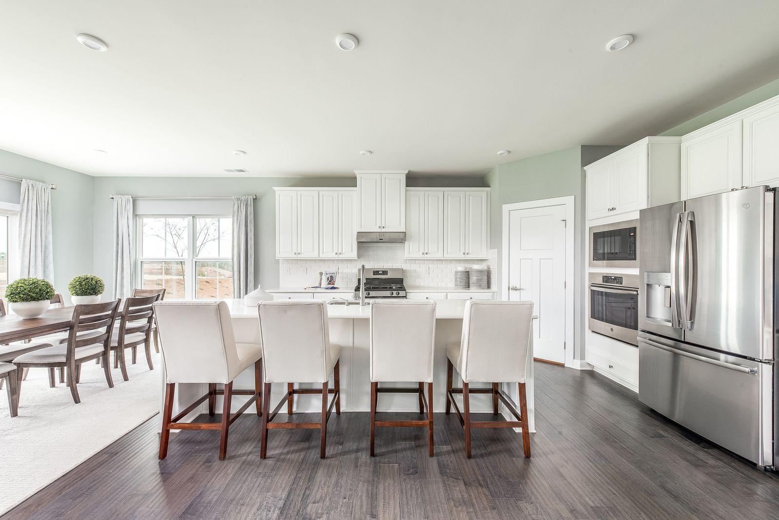 Kitchens include large islands and plenty of cabinet space