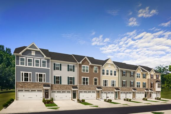 Craftsman style three level two-car garage townhomes with partial stone fronts and backyards:Click here to schedule yourone-on-one visit or virtual appointment today! We can't wait to help you find your dream home.
