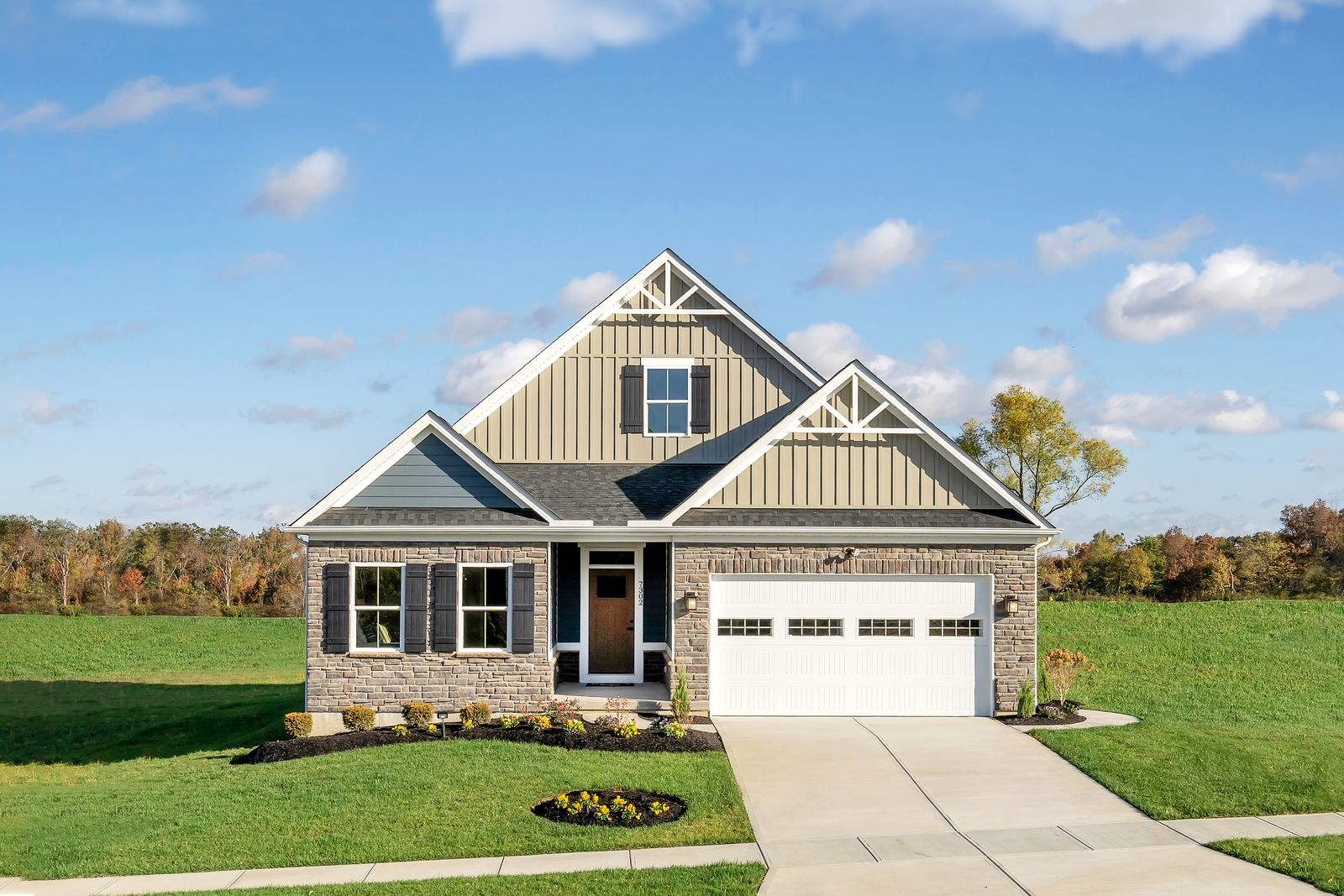 WELCOME HOME TO RAVINES AT HAZELWOOD:Modern convenience & rural atmosphere w/ low taxes-low $300's! Wooded, no-rear neighbor homesites with ext garage options! Near I-70, Rt. 161 & 310.Click Here to Schedule Your Visit Today!
