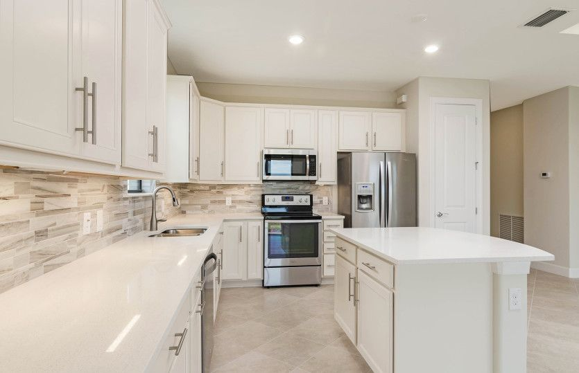 Marina:Kitchen with stainless steel appliances and maple cabinets