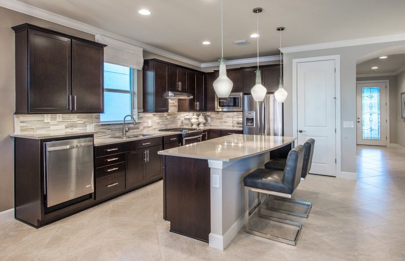 Abbeyville:Kitchen with center island and stainless steel appliances