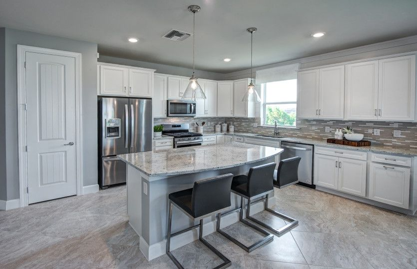 Oasis:Kitchen with stainless steel appliances and optional center island