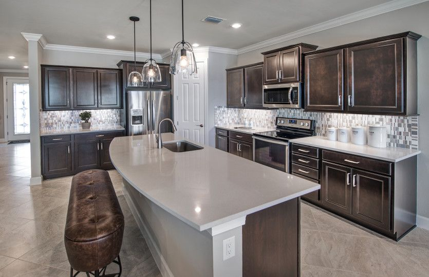 Citrus Grove:Kitchen with center island and stainless steel appliances
