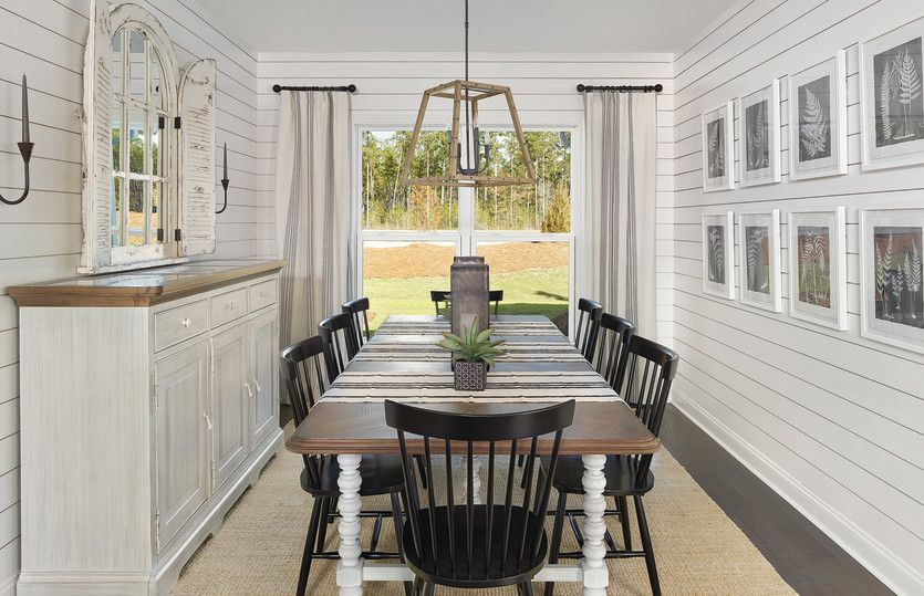 Summerwood:Elegant dining room with shiplap walls, decorative lighting and room for a large table are perfect f