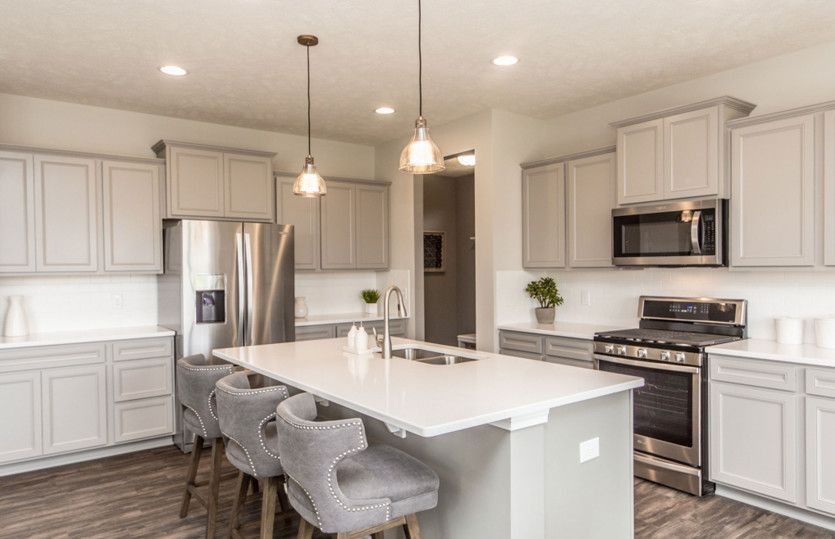 Boardwalk:Gourmet Kitchen with White Cabinets and Pendant Lighting
