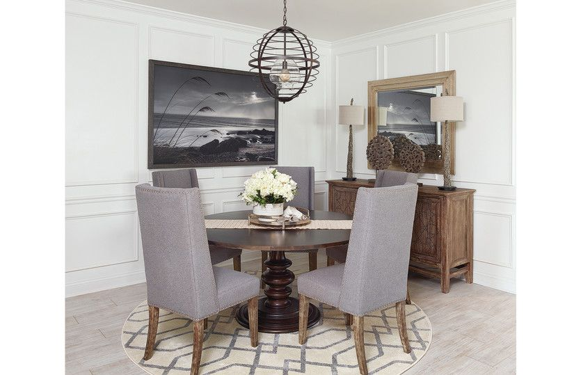 Martin Ray:Elegant dining area with custom molding and special lighting.