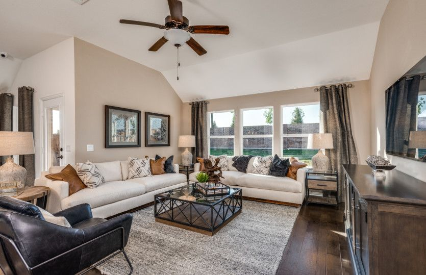 Mckinney:Gathering room, open to the kitchen with views of the backyard, optional fireplace available