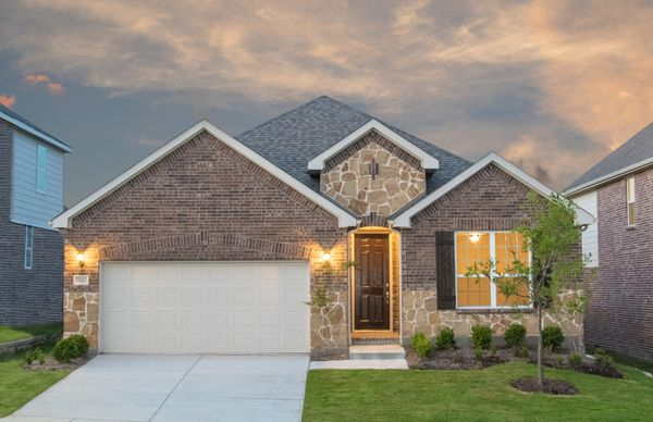 Exterior:Exterior C with stone accents, wood shutters, and 2-car garage