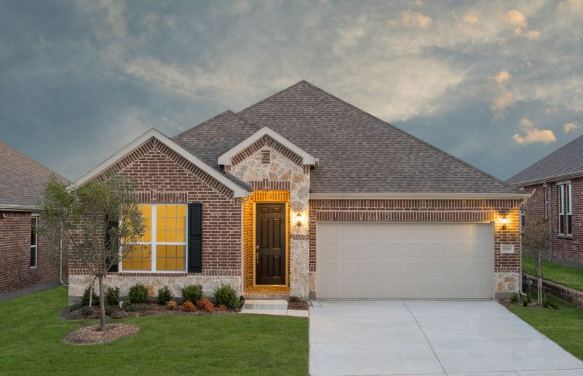 Dayton:The Dayton, a one-story home with 2-car garage, shown with Home Exterior B