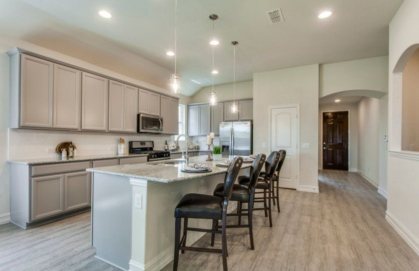Sheldon:Inviting foyer leads to the eat-in kitchen featuring your choice of granite or quartz countertops