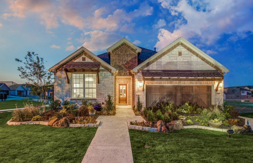 Mooreville:The Mooreville Exterior D, a two-story home with 2-car cedar garage with additional storage space