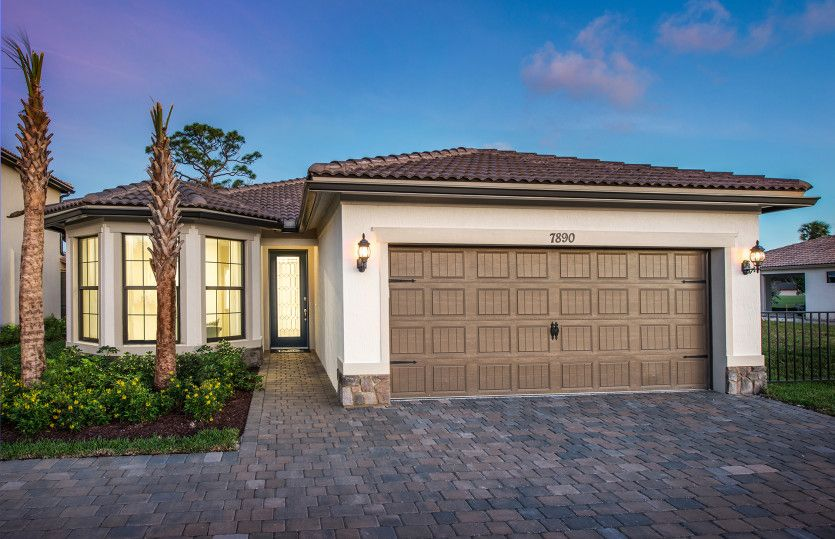 Wyndham:The Wyndham, a one-story family home with a 2 car garage, shown with Home Exterior FM2B