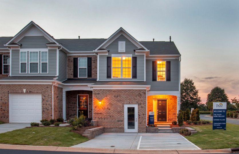 Grisham:Grisham Exterior 5 features brick, siding, covered front door and 1 car garage
