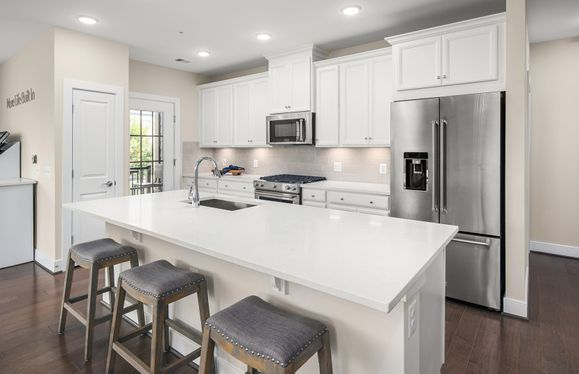 Exterior:Model Representation - Bright and Open Kitchen Featuring Quartz Countertops and Stainless Steel Appliances