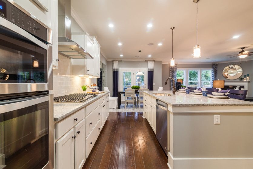 Vanderbilt:Beautiful Kitchen with over-sized kitchen island, white cabinets and gas Stainless Steel Appliances.