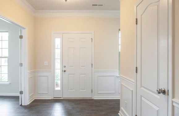 Rhodes:Bright foyer with Flex Rm/Library, Coat Closet and Powder Room