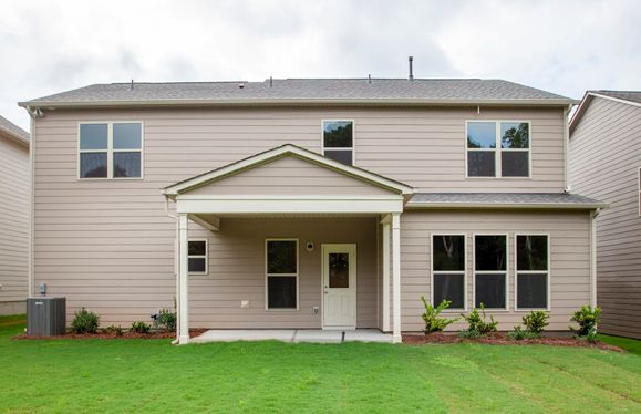 Rhodes:Rear exterior with 4' Gathering room extension and covered lanai