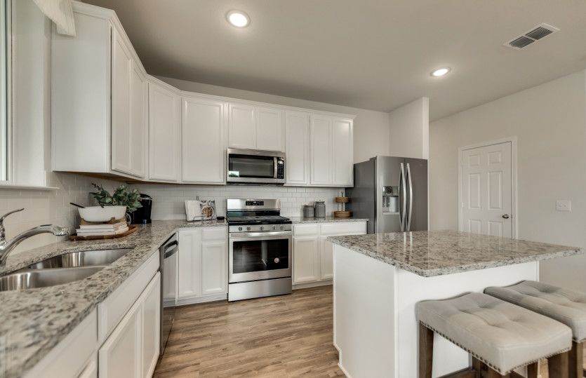 Killeen:Spacious kitchen with recessed lighting and island