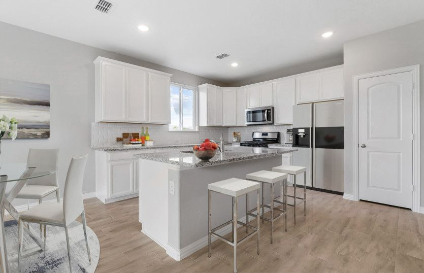 Parker:Spacious island kitchen with recessed lighting