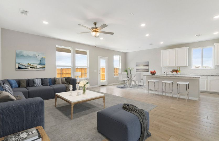 Parker:Gathering room with view of kitchen and dining areas