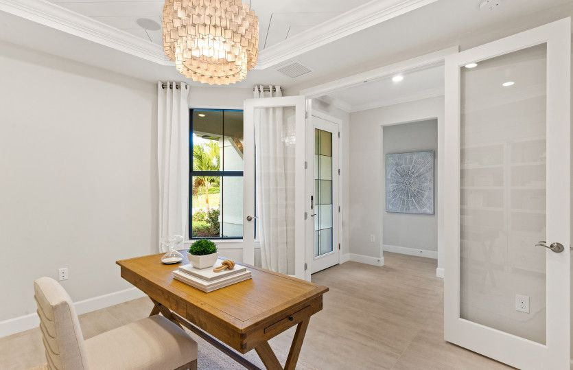 Reverence:Enclosed flex room with doors, perfect for a home office or den