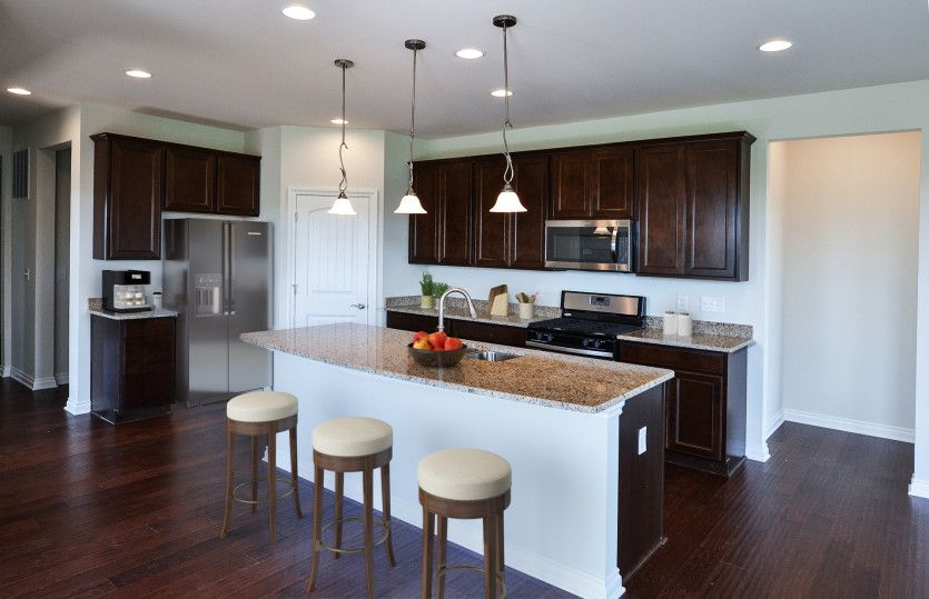 Bedrock:Spacious Kitchen with large island, granite countertops and stainless steel appliances.