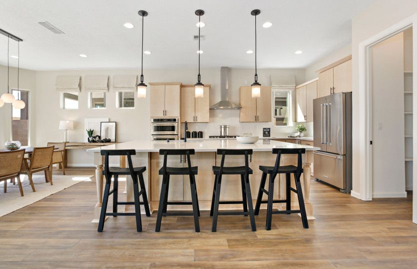 Patagonia:Spacious kitchen features a large, extended island with accent lighting fixtures to enjoy your morni