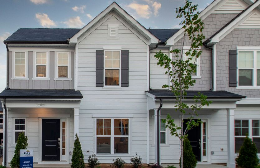 Griffin:Griffin Exterior 6 features siding, covered front porch and 1-car rear load garage
