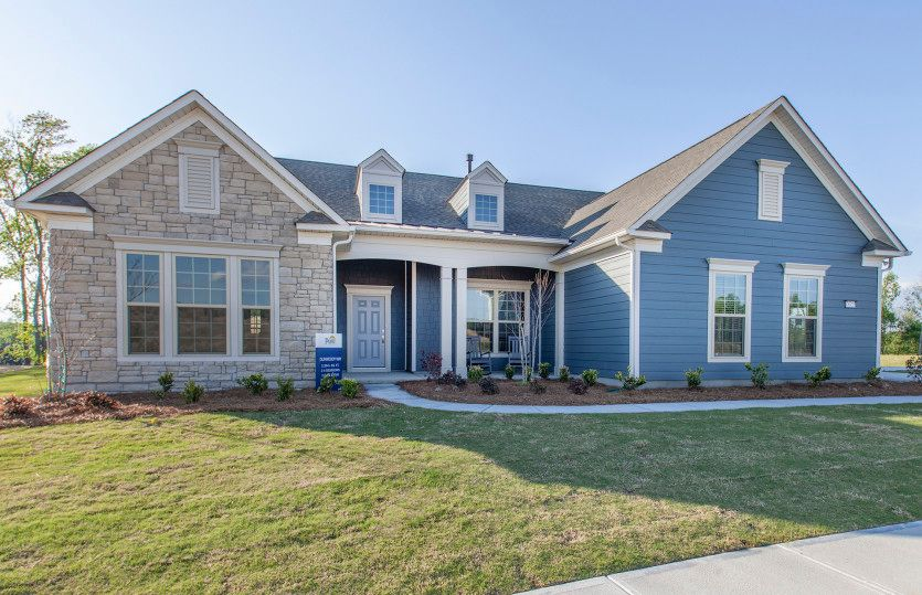 Dunwoody Way:Dunwoody Way Exterior 5 features stone, siding, covered front porch and 2 car side load garage