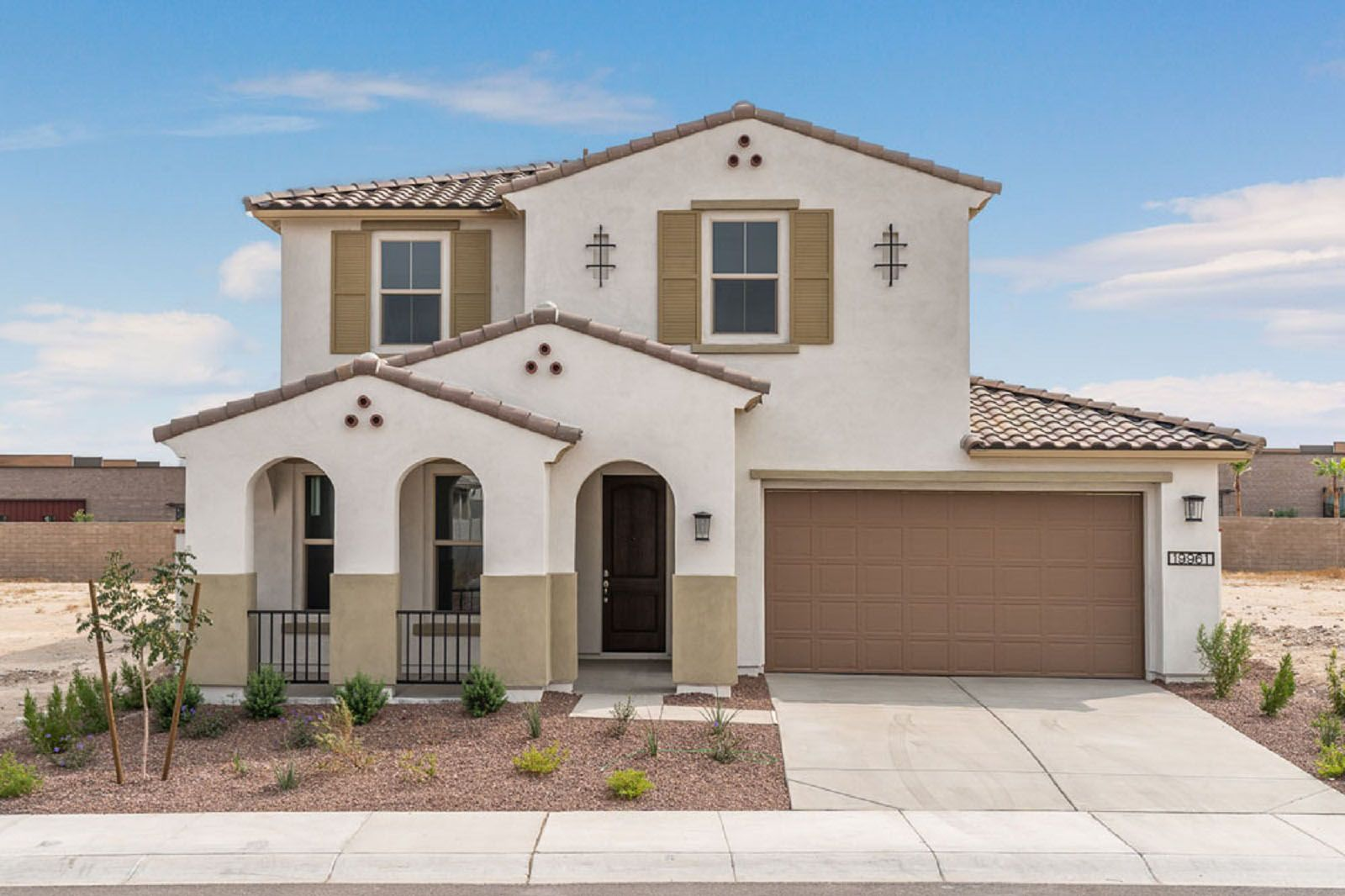 The Front Exterior of a Sierra, a new home for sale in Buckeye, Arizona from William Ryan Homes A...:Sierra Quick Move-In Home - Open Concept Floor Plan - Front Exterior