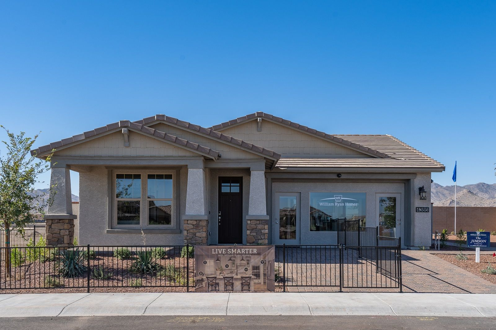 The Front Exterior of the Jimson model, a new home for sale in Buckeye, AZ from William Ryan Home...:Jimson Model Home - Open Concept Floor Plan - Front Exterior