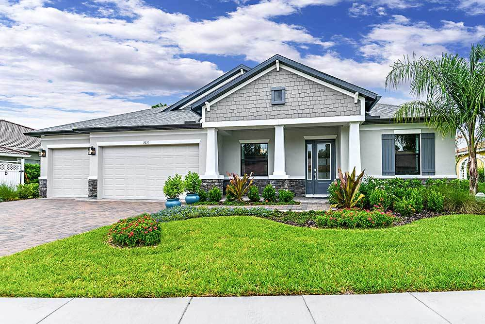 La Paloma in the Villages at Cypress Creek Joyce model home elevation 2 with stone William Ryan H...:La Paloma in the Villages at Cypress Creek - Joyce Model Home - Elevation 2 with Stone
