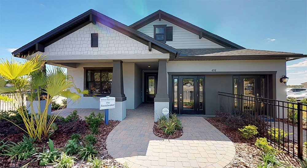 Sweetwater model home front exterior Hawthorn at the Villages of Avalon Spring Hill FL William Ry...