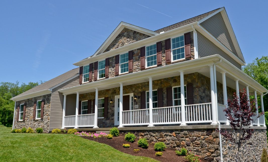 The Amesbury:Elevation C with opt. wrap around porch and partial stone