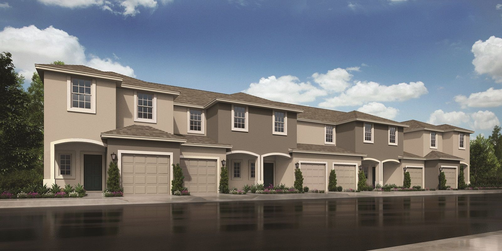 Row of 6 two-story townhomes with single car...