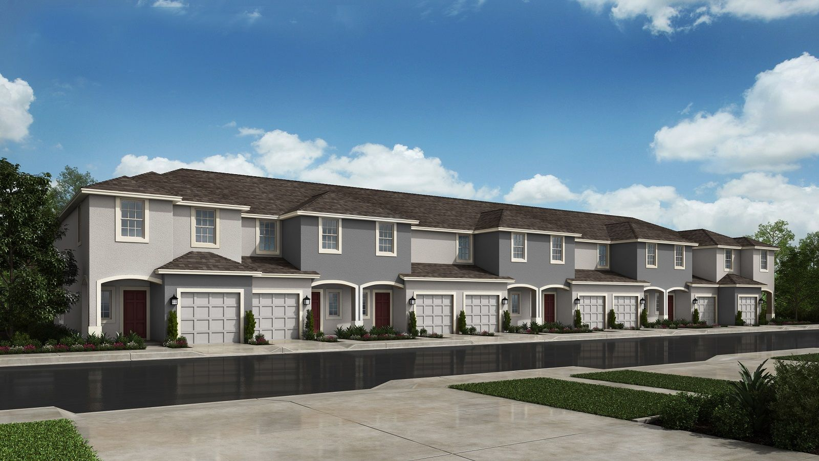 Row of 8 two-story townhomes with single car...