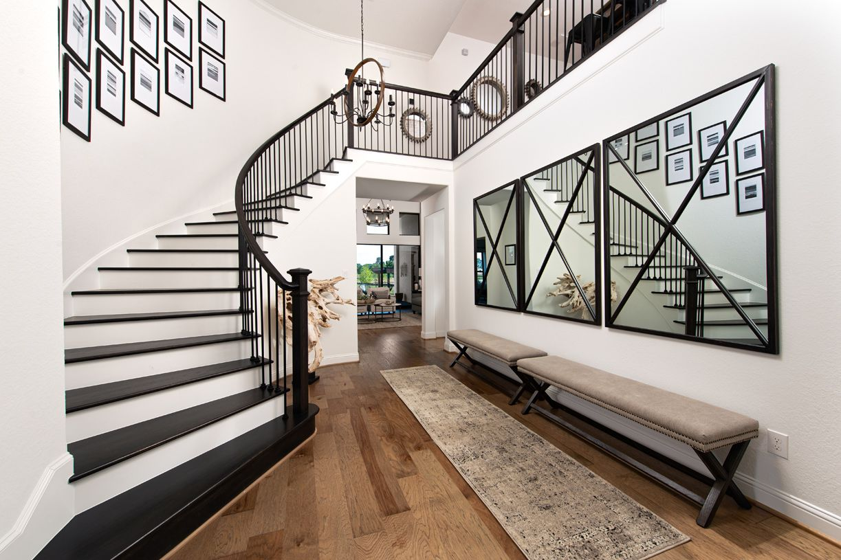 Interior Image:Two-story foyer with elegant curved staircase