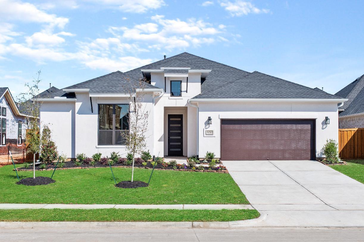 Elevation Image:Great curb appeal with modern stucco exterior