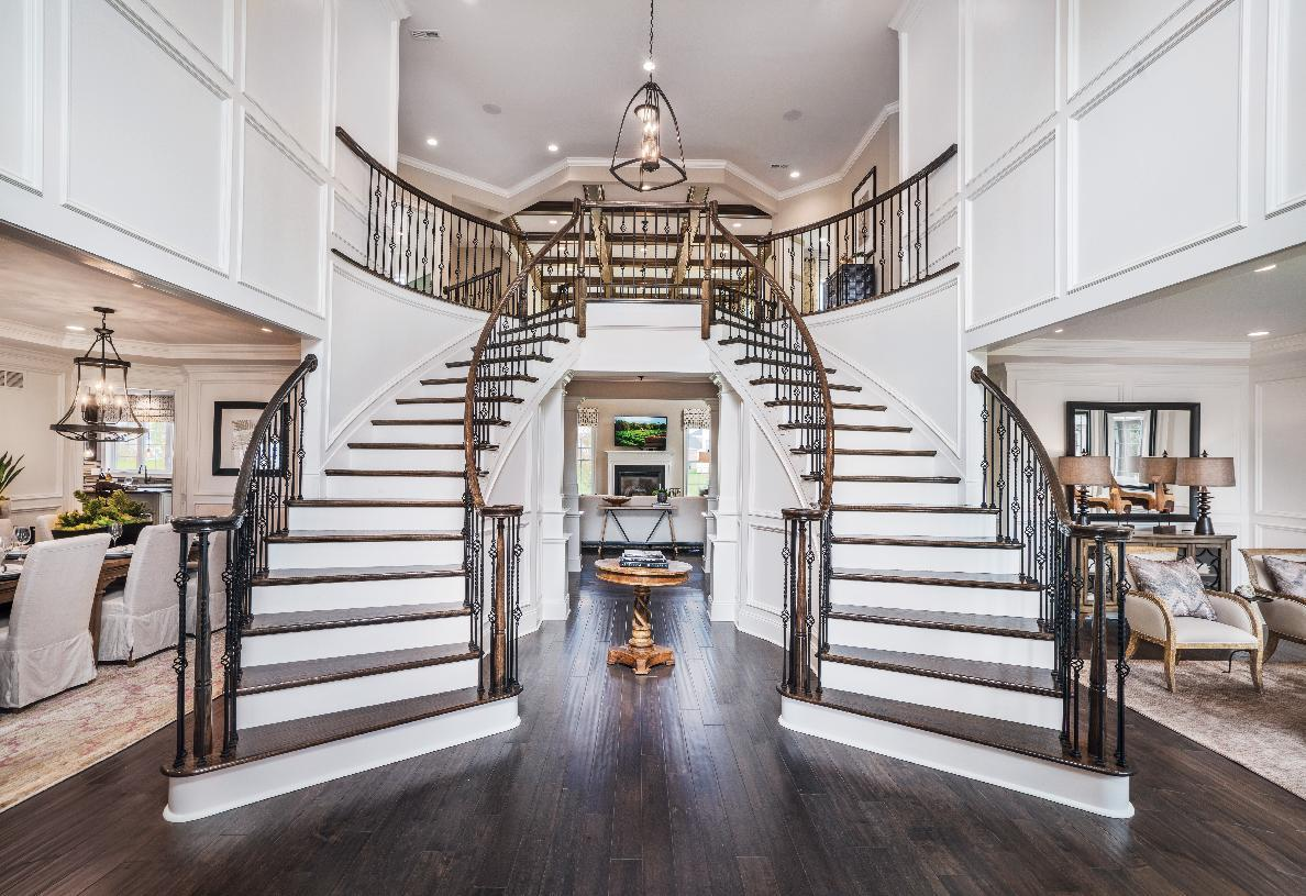 Interior Image:Dramatic entry foyer with double staircases – shown with optional curve
