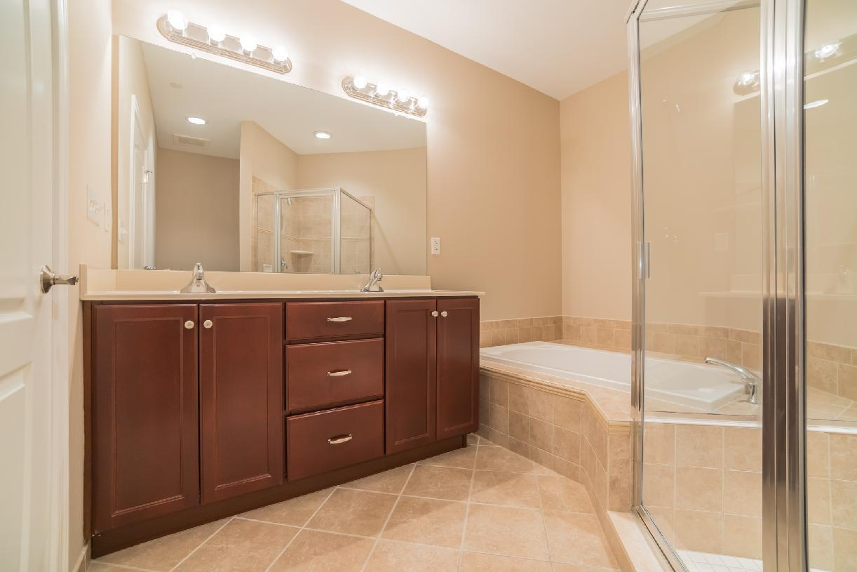 Elevation Image:Primary Bath Features Dual-sink Vanity, Soaker Tub, and Large Shower