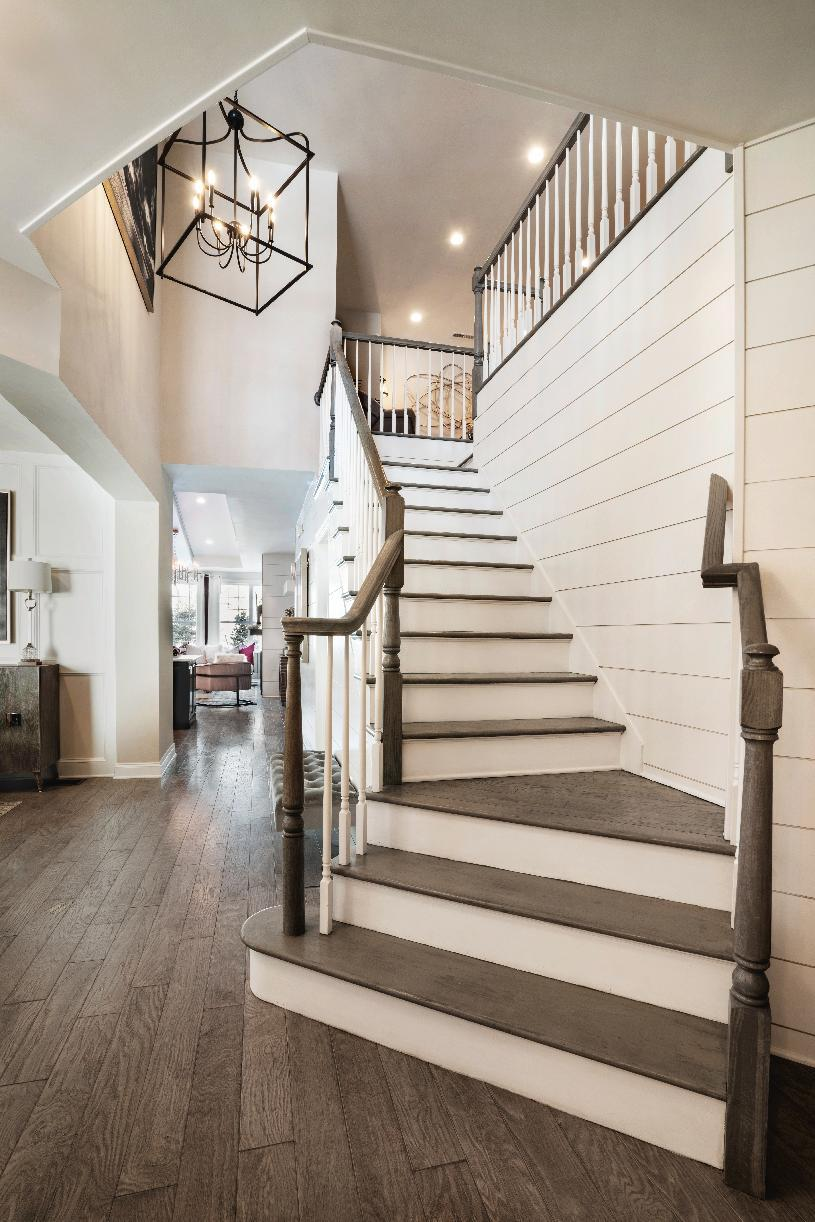 Interior Image:Foyer open to dining room and staircase to the second story