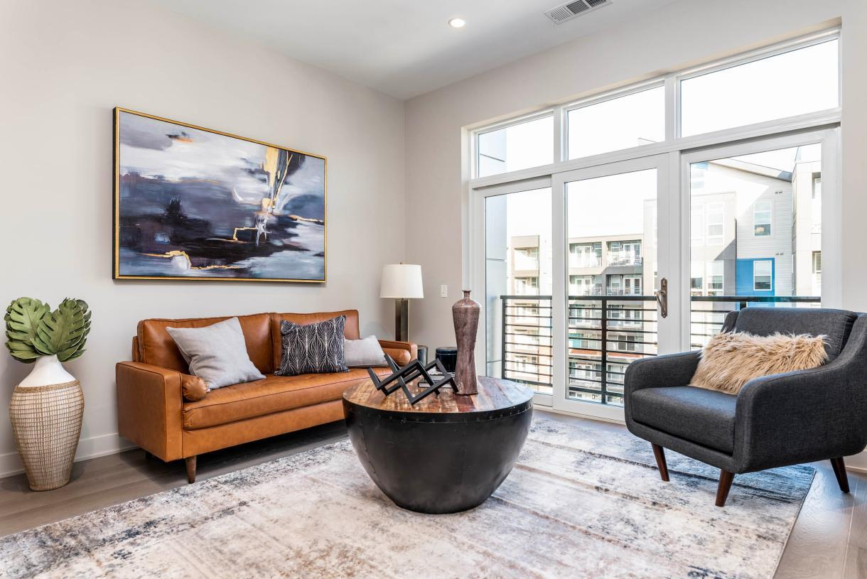 Elevation Image:Representative photo: Great room leads to private balcony